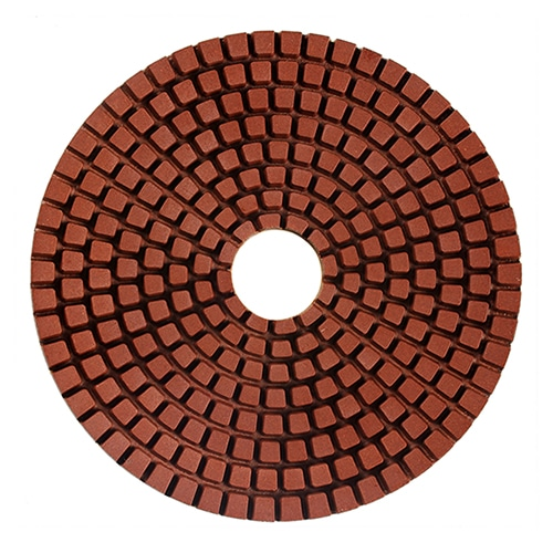 Flexible copper impregnated wet polishing pad